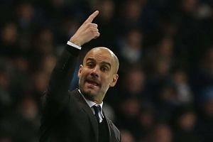Manchester City's manager Pep Guardiola gestures during the match.