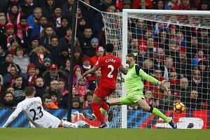 Swansea's Gylfi Sigurdsson finishing past Liverpool's Simon Mignolet to hand his side a first win at Anfield and a much-needed three points to haul them off the foot of the table.