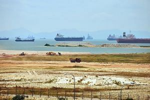 Singapore depends on sand for both reclamation (left) and construction activities.