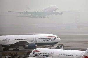 The foggy conditions affected some 100 out of 1,300 scheduled flights at London Heathrow airport.