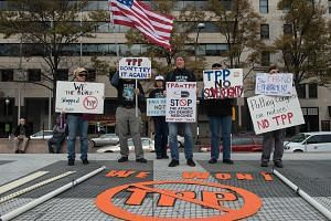 Protesters in the US calling for the rejection of the Trans-Pacific Partnership last year. While President Donald Trump wasted no time in ripping up the trade deal, a new study has found estimates of the impact of trade agreements on the US trade bal