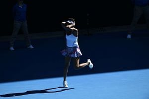Venus Williams celebrates her victory against Coco Vandeweghe during their women's singles semi-final match at Australian Open tennis tournament in Melbourne on Jan 26, 2017.