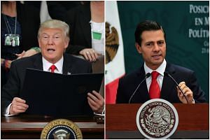 US President Donald Trump (left) said that his Mexican counterpart Enrique Pena Nieto should cancel his upcoming visit to Washington if Mexico refuses to pay for a wall along the border. IMAGES