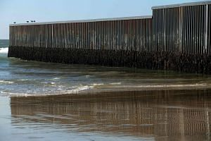 View of the US- Mexico border fence in Playas de Tijuana, northwestern Mexico on Jan 26, 2017.