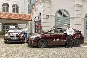 SMRT cabbies Muhammad Nur Dzhorif (left), 32, and Tay Seng Kok, 58, are considering signing up for the Taxi Share scheme so they can enjoy more work flexibility. The scheme, which will allow cabbies to rent taxis at an hourly rate of between $5.80 an
