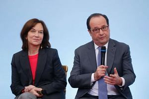 French President Francois Hollande (right) and Laurence Rossignol attend a ceremony to mark the International Day of Children's Rights  in Paris, on Nov 19, 2016.