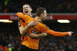 Wolverhampton Wanderers' Andreas Weimann celebrates scoring their second goal with Conor Coady.