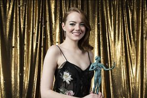Actress Emma Stone poses with her SAG award for Outstanding Performance by an Actress in a leading role for La La Land at the Shrine in Los Angeles, California, on Jan 29, 2017.