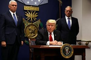 US President Donald Trump signing an executive order to impose tighter vetting of travellers entering the United States, at the Pentagon in Washington, US, on Jan 27, 2017.