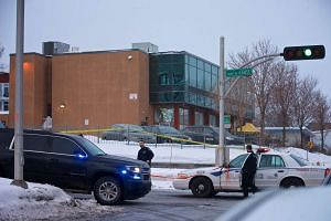 Municipal police patrols outside the Quebec mosque where two gunmen were originally thought to have opened fire during evening prayers on Jan 29, killing six people and injuring eight others.