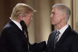 Judge Neil Gorsuch (right) speaks with US President Donald Trump after he was nominated for the Supreme Court, at the White House in Washington, DC, on Jan 31, 2017.