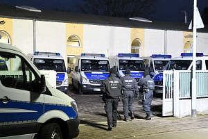 German police arrested a Tunisian man suspected of recruiting for the Islamic State group and planning an attack, as they carried out sweeping raids in the west of the country.