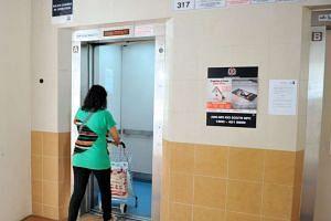 A woman entering a lift at Block 317 in Ang Mo Kio Street 31.