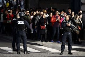 People are evacuated from the Louvre by French police after an armed man tried to rush into the museum, on Feb 3, 2017.