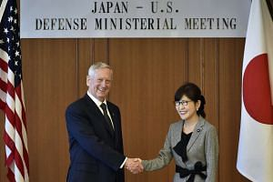 US Secretary of Defense James Mattis shaking hands with Japanese Defense Minister Tomomi Inada prior to their meeting at the defense ministry in Tokyo, Japan, on Feb 4, 2017.