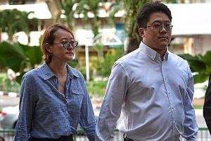 Ong Jenn and his wife arriving at the State Courts yesterday for the start of his four-day trial. The prosecution says that when Ong was arrested at a taxi stand in 2014, he had $2,000 on him to pay a man for two blocks of cannabis.