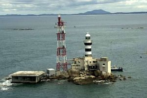 An aerial view of Horsburgh Lighthouse on Pedra Branca