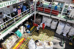 Some 2,200 tonnes of aid, comprising food and medicine, on the vessel Nautical Aliya at Port Klang, Selangor, as Malaysia yesterday flagged off its humanitarian mission bound for the Rohingya community in Myanmar.