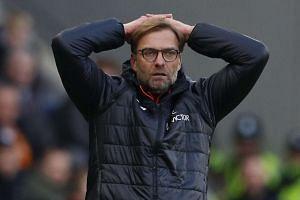 Liverpool manager Juergen Klopp looks dejected.