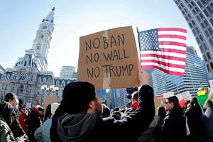 Demonstrators gather to protest against US President Donald Trump's executive order banning refugees and immigrants from seven primarily Muslim countries from entering the United States in Philadelphia, Pennsylvania on Feb 4, 2017.