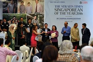 The Schooling family is The Straits Times Singaporean of the Year 2016. Deputy Prime Minister Tharman Shanmugaratnam presented the award of a trophy and $20,000 cash prize to the family at the award ceremony held at the UBS Business University.
