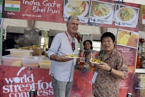 TV host, chef and author Anthony Bourdain with K.F. Seetoh, founder of Makansutra, at the food Jamboree at the World Street Food Congress in 2013.