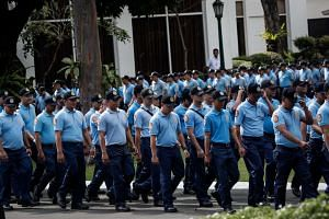 Policemen allegedly involved in various crimes marching inside the Malacanang presidential palace in Manila, Philippines, on Feb 7, 2017.