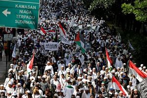 Members of the Front Pembela Islam (FPI) march to police headquarters during a protest in Jakarta, Indonesia on Jan 23, 2017.