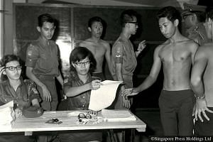 1967: The year in which the building up of a citizen military for newly independent Singapore began. An inaugural batch of able-bodied young men turns up on the first day of registration at Kallang Camp.