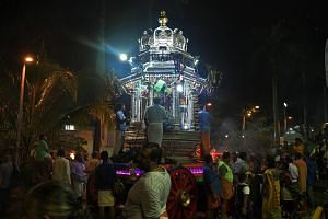 The chariot carrying Sri Murugan arrives at the Sri Thendayuthapani Temple in the evening of Feb 8, 2017. For the second year running after 42 years, live music is being played at the procession during the Thaipusam festival.