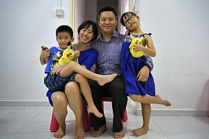 "Above: Mr Chua, his wife Angel and their son Ace. As a result of their three-year stay in Dubai, Ace had to catch up on his studies and get used to a ""different culture"" in school here upon their return. Left: Mr Toh, his wife Melissa and their son N"