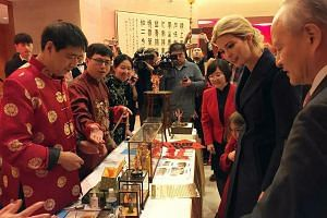 Ms Ivanka Trump attending a Chinese New Year reception at the Chinese Embassy in Washington last week with Chinese ambassador Cui Tiankai (far right). While Mr Trump has not spoken to President Xi since taking office, the visit by his daughter, and h