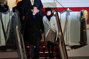 Japanese Prime Minister Shinzo Abe and his wife Akie Matsuzaki arriving at Andrews Air Force Base in Maryland, just outside Washington, DC, on Feb 9, 2017.