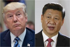 US President Donald Trump (left) affirms 'one China' stance in call with his Chinese counterpart Xi Jinping.