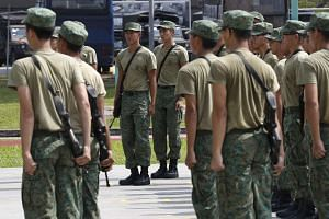 Military recruits at the Basic Military Training Camp on Pulau Tekong. The Committee on the Future Economy has recommended using national service to train army personnel in cyber security skills to prepare for the digital future.