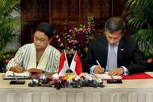 Dr Balakrishnan (right) and his Indonesian counterpart Retno Marsudi exchanged ratification instruments for the pact in a ceremony at the Foreign Affairs Ministry.