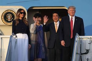 US President Donald Trump and his wife Melania Trump arriving with Japan Prime Minister Shinzo Abe and his wife Akie Abe on Air Force One at the Palm Beach International airport, on Feb 10, 2017, in West Palm Beach, Florida, US.