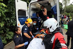 Members of the SCDF attending to injured people after the collapse of the Tembusu tree on Feb 11, 2017.