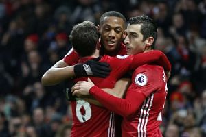 Manchester United's Anthony Martial celebrates scoring their second goal with Henrikh Mkhitaryan and Juan Mata.