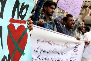 People shout slogans during a protest against Valentine's Day in Karachi, Pakistan, on Feb 12, 2017.