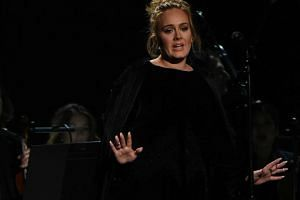 British singer Adele flubbed her tribute to late singer George Michael, apologising profusely for her swearing.