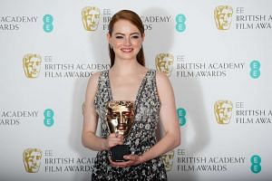 Emma Stone holds the award for leading Actress for La La Land at the Baftas.