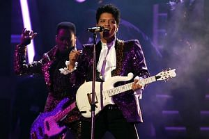 Bruno Mars performing a tribute to Prince during the 59th Grammy Awards, on Feb 12, 2017.