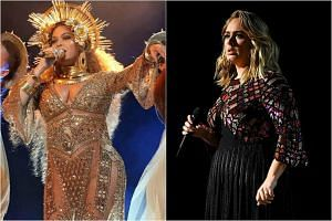 Beyonce and Adele performing at the 59th annual Grammy Awards ceremony.
