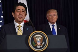 Japanese PM Shinzo Abe speaking during a joint press conference with US President Donald Trump, regarding the test-firing of a missile by North Korea, on Feb 11, 2017.