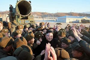 North Korean leader Kim Jong Un surrounded by soldiers of the Korean People's Army while inspecting the test launch of the Pukguksong-2 intermediate- range ballistic missile on Sunday at an undisclosed location.
