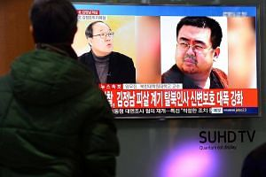 People watching a TV screen broadcasting a news report on the assassination of Kim Jong Nam, at a railway station in Seoul, South Korea, on Feb 14, 2017.