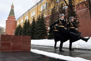 Russian Kremlin Guards goose-step along the Kremlin wall in Moscow on Feb 11, 2017.