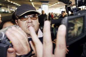 A 2007 photo shows a man believed to be Kim Jong Nam walking among journalists upon his arrival at Beijing's international airport.