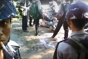A screen grab from a YouTube video showing a policeman kicking a Rohingya minority villager in Kotankauk village during a police area clearance operation on Nov 5, 2016.